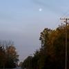 October 15, 2019:  Looking west at sunrise to the full moon beginning to set.