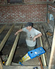 June 18, 2010:  Bob begins to put the shed floor back together again.