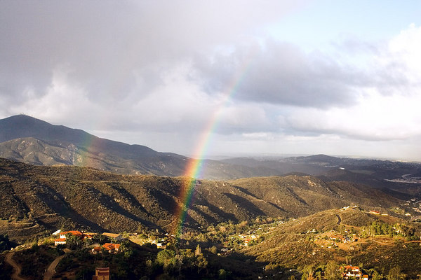 """February 28 - Rainbow - The """"big storm"""" fizzled out. We just had a few showers. This was around 7:30 in the morning. We actually had a bit of HAIL at 9:25am, along with the sunshine! So the weatherman was saved. He had said, """"wind, rain, and hail""""."""