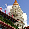 """2008.12.15 (Mon) -  <a target=""""_blank"""" href=""""http://www.penang-traveltips.com/kek-lok-si-temple.htm"""">Kek Lok Si Temple</a>: from 2002 archives  Had a good day at work today, I was very busy with software design specfications.  Got home and hung out with the family, ate dinner with Robin and then the two of us went for a three mile walk.   We were both a very tired after our walk and turned in for the night.  I realized that I hadn't taken a photo but was too tired to care and decided to post for today from my archives.   This one goes way back to 2002 when I was on a business trip with some of my group at Intel.  We spent 6 weeks in Penang Malaysia starting up a new global call center there.  This shot is of the Kek Lok Si Temple at Air Itam, Georgetown.  It is the largest Buddhist temple in Southeast Asia and quite beautiful!  This was taken with my Point-n-Shoot Olympus before we got our SLR but it is a nice capture.  I wish I could go back with a real camera and shoot here again knowing what I do now.  Who knows, maybe someday...  Until tomorrow,  Darron"""