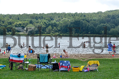 Beach-goers enjoy the waters of Lake Arthur during the 20th annual Regatta.