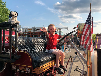 Nathan Kowalski, 3, of Cranberry Township, sits on the township's 1928 fire engine Tuesday during the National Night Out celebration.