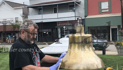 Photos by J.W. Johnson Jr.David Phileger, who served on the USS Mars, works to polish the ship's bell Wednesday.
