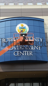 Steve Peffer works on Sunday to hang the state seal he crated for the county government center.Photo by Paula Grubbs