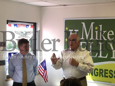 Congressmen Keith Rothfus, R-17, and Mike Kelly, R-16, speak Thursday to a crowd gathered at the new Republican Women of Butler County Campaign Central Headquarters in Cranberry Township. 5 col.