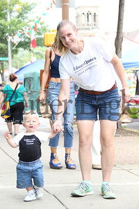 Ella Heeter, 28, of Cranberry Township shows her son, Rodney, around the Butler Italian Festival. 2018 Lauryn Halahurich/Butler Eagle