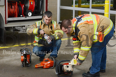 Tim Barch, left, and Sean Morrison, members of the Cranberry Township Volunteer Fire Department, check equipment Friday at the Haine Station.