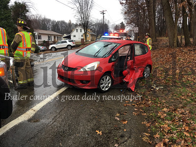 The driver of the red car in the distance suffered minor injuries in a two-car accident at intersection of Meridian and Whitestown roads in Butler Township on Saturday.