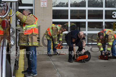 Photos by J.W. Johnson Jr.Members of the Cranberry Volunteer Fire Department check equipment Friday at the Haine Station.