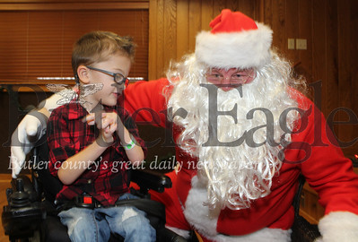 Harold Aughton/Special to the Eagle: Calder Hefferan,4, of Butler and who turns 5 Christmas Eve, shares what he would like for Christmas with Santa  at the Butler Twp. parks & Recreation building Saturday morning. (Uncropped)
