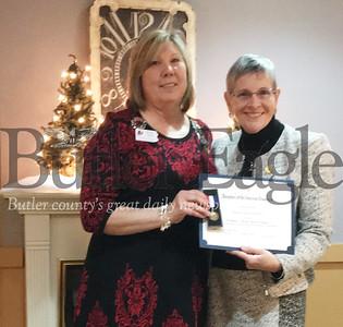 "U.S. District Judge and former Butler County Common Pleas Court Judge Marilyn Horan, right, accepts a ""Women in American History Award"" and medal from Diana Grady of the Daughters of the American Revolution during a luncheon Saturday in Butler."