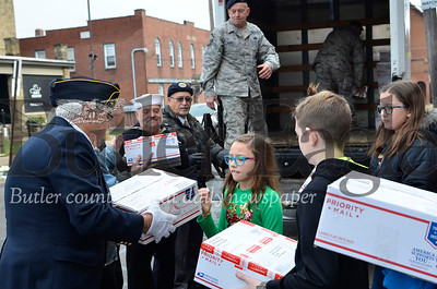 Butler Middle School students hand packages to members of Chicora's American Legion and the 911th Airlift Wing. The men loaded the packages into a truck for mailing to an Air Force base overseas. Tanner Cole/Butler Eagle