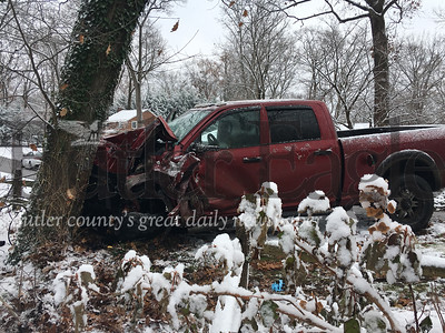 "No one was injured about 2:35 p.m. when a man lost control of his Dodge Ram pickup truck and slammed into a tree on Woodridge Road in Butler Township. The driver, a man believed to be in his 20s, told officers that he ""lost his brakes,"" township police said.Before the truck hit the tree, it took out a mailbox on nearby Belmont Road. It was snowing around the time of the crash but police said they do not believe road conditions were a factor.The wreck remains under investigation."