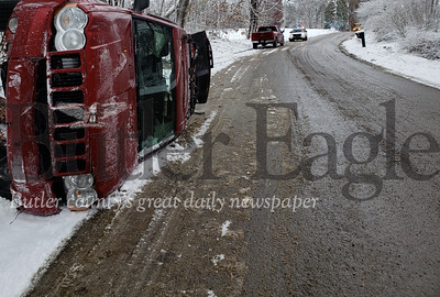 A driver flipped her vehicle but was unharmed during snowfall on Eagle Mill Road Wednesday afternoon, according to state police. The accident was attributed to poor road conditions.