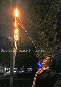 Harold Aughton/Special to the Eagle: Butler County Commissioner Kimberly Geyer lights the menorah in celebration of Hanukkah at the Cranberry Twp. Municipal building Sunday.