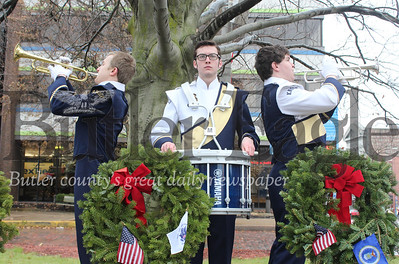 Harold Aughton/Special to the Eagle: (left-right) Knoch's Robert Wolf, first trumpet; drummer Brenden Smith and Braydon Sloan, 2nd trumpet, play taps during Wreaths Across America local ceremony at noon Saturday, Dec. 15, at Diamond Park. Conducted by the General Richard Butler Chapter, NSDAR.