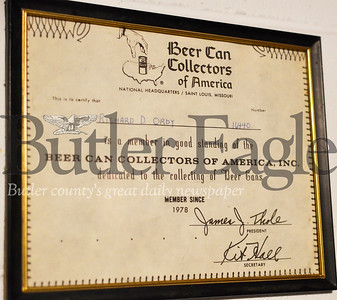 Rich Ordy isn't a member anymore, but he still displays his old membership certificate for the Beer Can Collectors of America. Tanner Cole/Butler Eagle