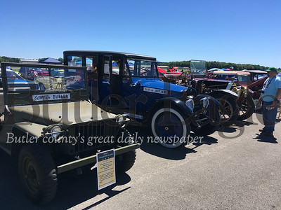 The Old Stone House chapter of the Antique Automobile Club of America brought Butler's 1941 Bantam, right, and the club's 1922 Standard and 1909 Huselton to the Mega Cruise Saturday.