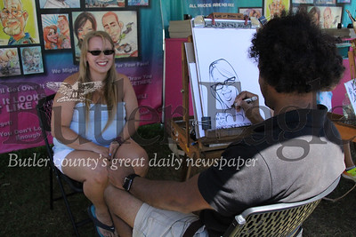 Nicole Hays, 24, of Hampton Township, gets her caricature drawn by Alani Jimenez, 34, of Lehigh at the Big Butler Fair on July 7, 2018.