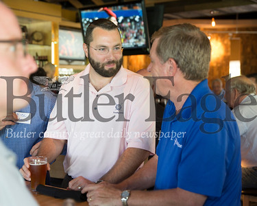 Ethan Nicholas, left, speaks to a fellow member of the 100+ Men Who Care Pittsburgh group during a recent meeting in Wexford.