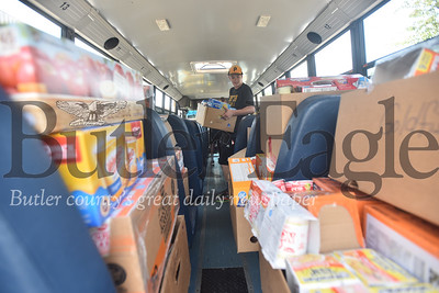 57128 Butler's first annual Stuff A Bus to benefit Butler School District's Kid's Weekend Backpack Program on North Washington Street between the YMCA and Emily Brittain Elementary School.