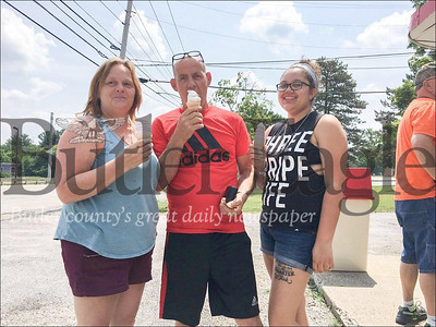 Edwards Ice Cream Photo: From left to right, Gisela Heusser, Klaus Heusser and Jovan Heusser of Butler enjoy their ice cream on the opening day of Edwards Ice Cream, located on New Castle Road, Butler. The shop opened up Saturday, July 14, 2018. Rachael McKriger/Butler eagle