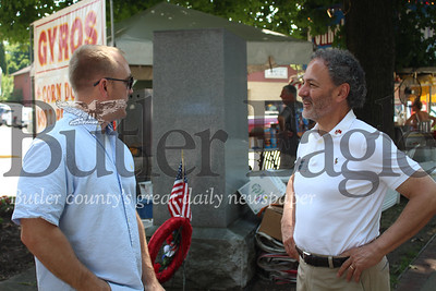 The annual Horse Trading Days Festival saw a visit by the District 16 democratic congressional candidate looking to spread the word about his campaign. Pictured here: Adam Readout, of Conoquenessing Township talks with Ron DiNicola at Horse Trading Days in Zelienople. (photo by caleb harshberger)