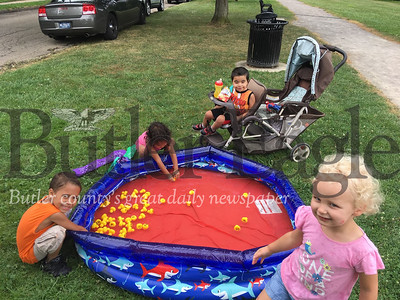 Elijah Franklin, left, Amiah Franklin, Kaylyb Franklin and Layne Barnes play in a pool during Action in Recovery's second annual Kids Day at Rotary Park in Butler Saturday.