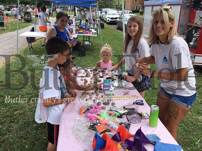 Amanda Haskin,an Action in Recovery Volunteer, helps children with rock painting at AIR's second annual Kids Day at Rotary Park in Butler Saturday.
