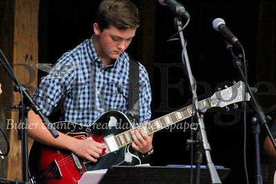 "Miles Weaver plays the guitar during the ""In Harmony"" Heritage Music Festival, Saturday, at the Harmonist-Ziegler Barn."