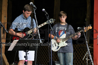 "Miles Weaver (left) and Evan Weston play their instruments during the ""In Harmony"" Heritage Music Festival, Saturday, at the Harmonist-Ziegler Barn."