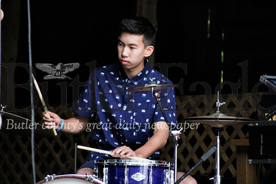 "Kai Roylo plays the drums during the ""In Harmony"" Heritage Music Festival, Saturday, at the Harmonist-Ziegler Barn."