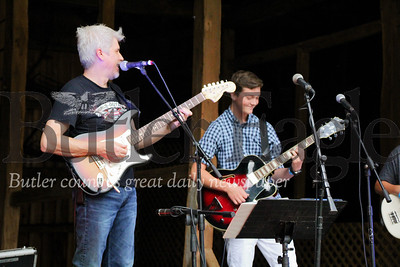 """Duane Davis, private music instructor, plays the guitar with his student Miles Weaver during the """"In Harmony"""" Heritage Music Festival, Saturday, at the Harmonist-Ziegler Barn."""