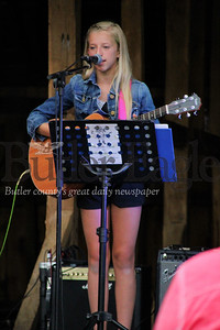 """Ella Tirch plays the guitar and sings during the """"In Harmony"""" Heritage Music Festival, Saturday, at the Harmonist-Ziegler Barn."""
