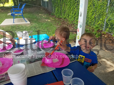 Brothers Julian and Henry Crawley participate in painting crafts at the South Hills Playground, as part of the Summer Food & Fun Program, sponsored by the Greater Pittsburgh Food Bank.