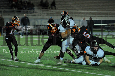 Moniteau #34 Cody Wise pushes past Clarion #4 Drew Wrhen & #5 Archer Mills  during a playoff game at Clarion University Stdium on Friday November 2, 2018 (Jason Swanson photo)