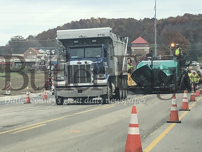 Crews work to pave Rochester Road in Cranberry Township on Wednesday.