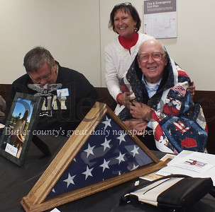 WWII veteran John Mahler wrapped in a Quilt of Valor that he received for his 100th birthday on Friday at Butler's VA. Photos by Eric Jankiewicz