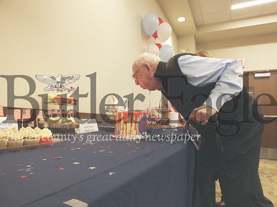 WWII veteran John Mahler blows the candles out on his birthday cake for his 100th birthday on Friday at Butler's VA. Photos by Eric jankiewicz