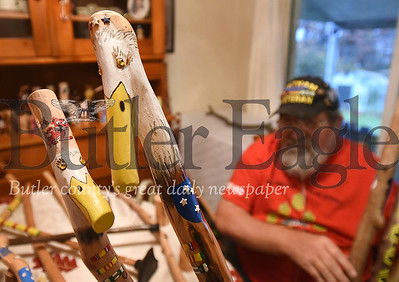 84951 Vietnam Veteran William Barbary shows the different walking sticks he makes for veterans at his home in Center twp