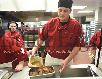 94395 Butler Vo tech culinary students show how to properly wrap and store leftovers