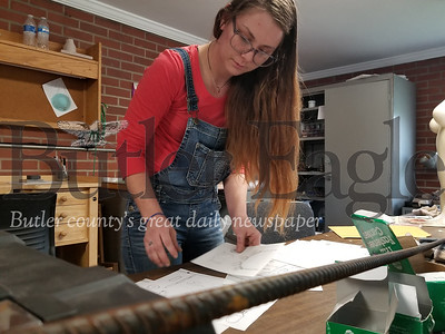 Chelsey Wermer, a senior at Slippery Rock University, works on jewelry pieces for her exhibition later this month at a stundent run gallery on campus.