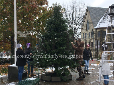 Helping in Butler Downtown's annual Christmas tree decorating (from left) are Loretta Crawford, Michael Crawford II, Michael Crawford, Madison Parker and Angela Arblaster, all of Butler.