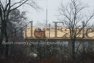 Photo by J.W. Johnson Jr.Crews work Tuesday to put a roof on a new building at the Cranberry Township Volunteer Fire Department station on Route 19.