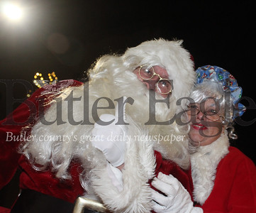 Harold Aughton/Special to the Eagle: Santa and Mrs. Claus were in the spot lighting Saturday evening during annual Butler Christmas parade.