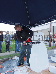 Local culinary student  Josalyn Stewart uses a chainsaw to sculpt an iceman on Sunday afternoon on West Slippery Rock Street. Photo by Eric Jankiewicz
