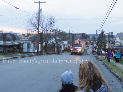 Santa Clause mounted atop Chicora's fire engine driving along West Slippery Rock Street. Photo by Eric Jankiewicz