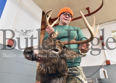 12073 Hunters show their deer at McKruit's Meats in Cabot