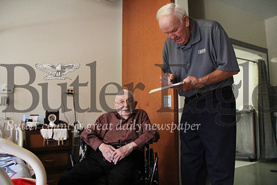 "Former umpire Larry Barnett signs a paper for John ""Sarge"" Kozlosky, a 98-year-old on Tuesday at the Abie Abraham VA Community Living Center."