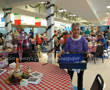 Judith A. Zadludek, a member of St. Michael the Archangle Roman Catholic Church, works at the church's Italian Festival Sunday at the social hall. Donna Sybert/Butler Eagle